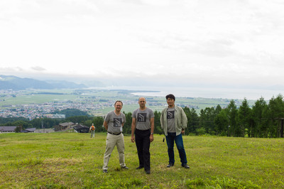 Safecast's Pieter, Joe, and Hideki Washiyama with Lake Inawashiro at their back.