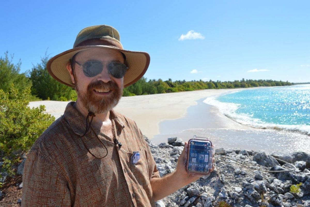 Dr. Buesseler with his nano on the beach at Bikini.